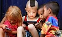 Children play video games in Cubao, Quezon City, metro Manila, Philippines.