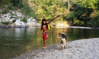 Embera girl with her dog. The Embera people live in Chagres National Park in northern Panama.