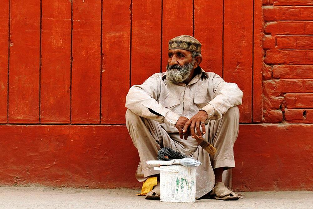 An unemployed painter waits to be hired for a temporary job in Peshawar.
