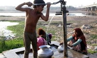 A Pakistani boy fetches clean water on World Water Day outside Lahore.