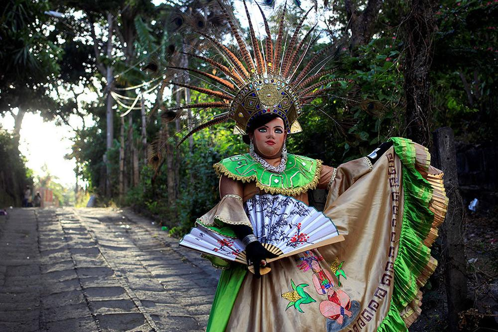 A masked dancer takes part in a celebration honoring the Virgin of Candelaria in Diriomo. Nicaragua.