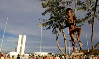 A Indio boy takes part in a demonstration against the violation of indigenous people's rights, in Brasilia, Brazil.