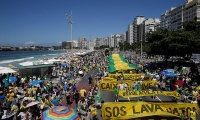 Demonstrators march along Copacabana Beach in Rio de Janeiro, Brazil, during a nationwide protest against political corruption.