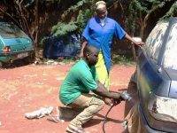 Burkina Faso. Alphonsine Yanogo. Sister and mechanic