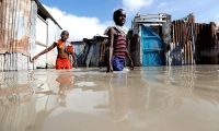 Somalia. Children wade through floodwaters after heavy rain in Mogadishu.