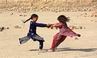 Girls play on the outskirts of Kabul.