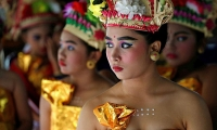 Indonesia. Balinese Hindu girls wait to perform the Rejang Dewa dance in Jakarta.