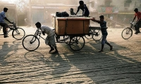 People carry their goods in Rickshaw in Dhaka, Bangladesh.