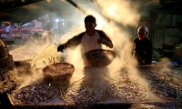 A worker marinates fish in the Cilincing district in Jakarta, Indonesia.