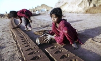 Pakistani Thaminah Sadiq, 7, works in a brick factory, on the outskirts of Islamabad. Pakistan.