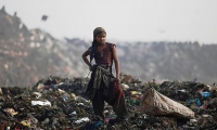 A girl collects recyclable material at a garbage dump in New Delhi.