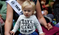 Demonstrators, including mothers and babies in defence of Mother Earth. London.
