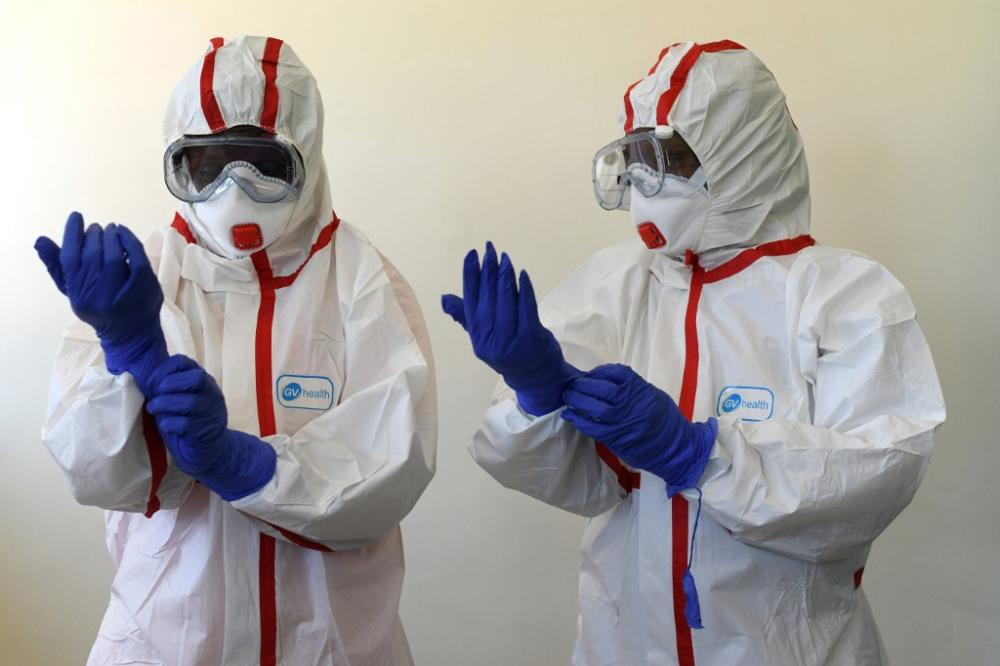 Kenyan health workers prepare for cases of the new coronavirus at the Mbgathi District hospital in Nairobi.