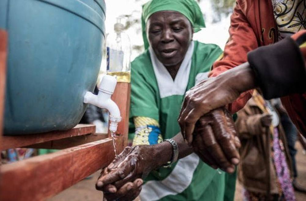 Women in the Democratic Republic of the Congo wash their hands.