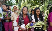 El Salvador. Catholic women take part in the Palm Sunday procession in Panchimalco.