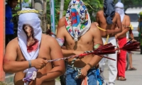 Philippines. In San Pedro Cutud hooded penitents perform self-flagellation.