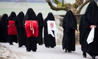 Switzerland. Veiled women known as mourning women commemorate the Passion and Crucifixion of Jesus in Romont.