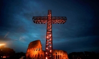 Italy. A cross is lighted before the arrival of Pope Francis for the Via Crucis torchlight procession at the Colosseum in Rome.