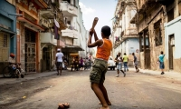 Boys playing baseball, Cuba's national sport.