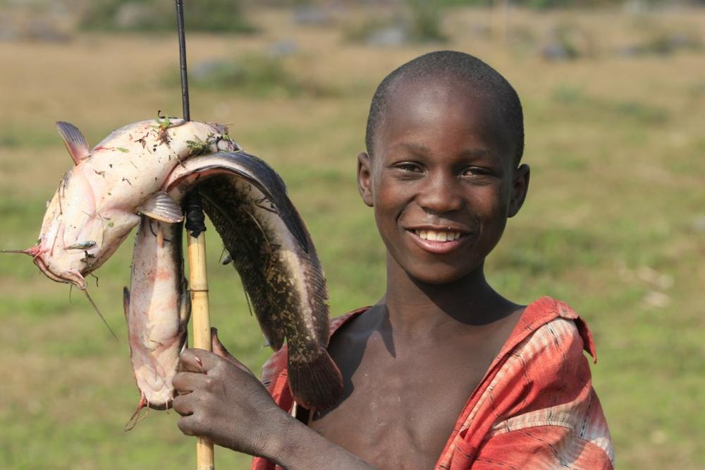 Zambia. Children learn to fish from very early.