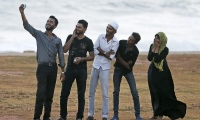 A young Muslim man takes a selfie with his friends in Colombo, Sri Lanka.