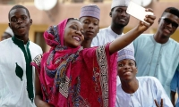 A Muslim woman takes a selfie with friends after Eid al-Adha at the prayer ground in Lagos, Nigeria.