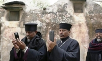 Ethiopian priests with their smartphones.