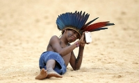 Indigenous boy from the Mamaind tribe uses a tablet during the Jikunahati competition.