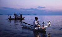 Local fishermen returning in their fishing boats after a day's fishing in Lake Malawi.