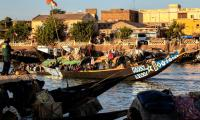 Mopti, Mali. Small canoes (pirogues) and larger craft (pinasses) ply the Niger River with passengers and cargo.