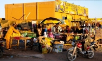 Market traders sell their goods outside the bus station in Agadez.