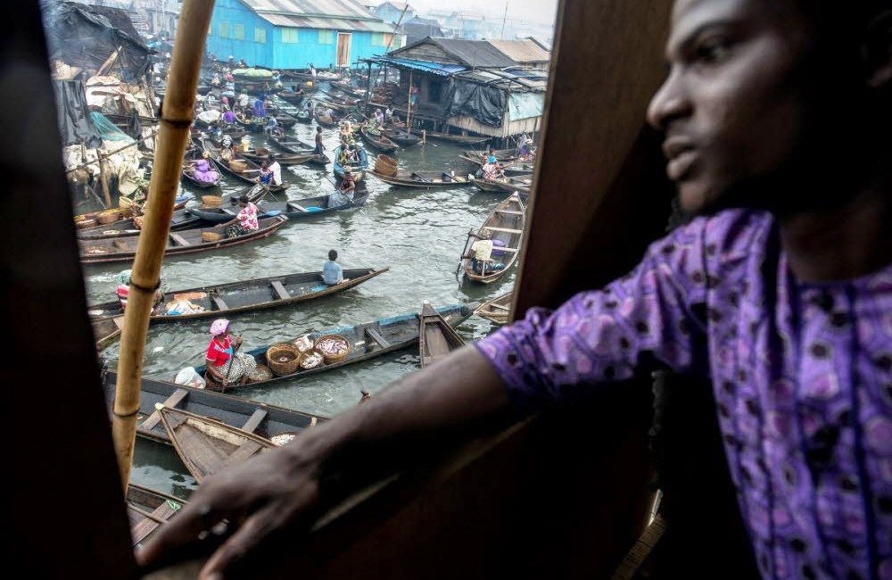 A man looks out from a window in the Makoko slum. Almost 200 year old community.