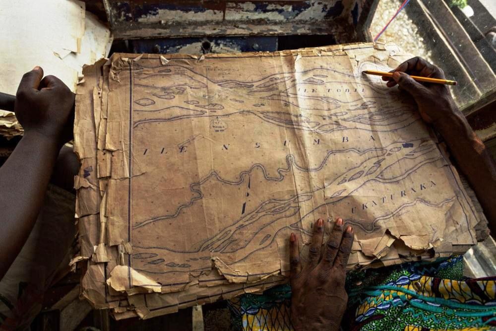 The old map dating from the Belgian colonial-era is still the only map used by boats travelling on the Congo River.