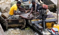 People playing draughts on board a vessel travelling on the Congo River.