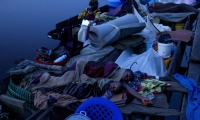 People sleep on board a ship travelling on the Congo River.