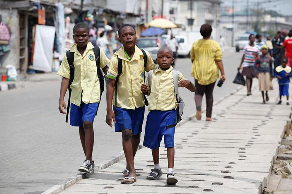 School children walk in the street in the Obalende area of Lagos, Nigeria.