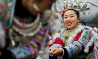 Ethnic Miao women in traditional costumes