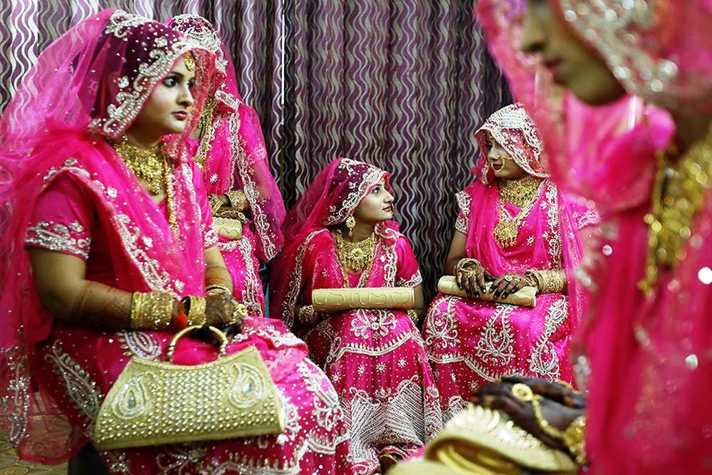 Muslim brides wait at a beauty parlour before the start of a mass marriage ceremony in Mumbai.