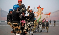India's female Border Security Force motorcycle riders, perform during a rehearsal for the Republic Day parade.