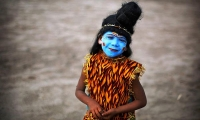 An Indian boy dressed as Hindu God Shiva on the occasion of the festival of Shivaratri in Allahabad.