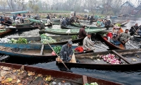 Vegetable vendors work at a floating market on Dal Lake in Srinagar, Indian-controlled Kashmir.