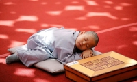 South Korea. A novice monk naps after getting his head shaved at Jogye Temple in Seoul.